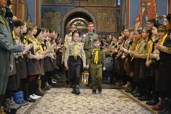 Members of Plast, the National scout organization of Ukraine, bring Peace Light of Bethlehem to Mykhailivskyi cathedral which is the main cathedral of the independent Ukrainian Orthodox church that was created in 2018.
